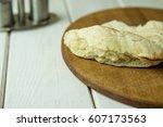 pita  bread on wooden surface | Shutterstock . vector #607173563