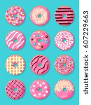 set of donuts with pink glaze... | Shutterstock .eps vector #607229663