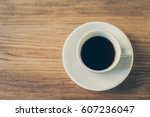 coffee cup on wooden table in...   Shutterstock . vector #607236047