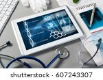 white tablet pc and doctor... | Shutterstock . vector #607243307