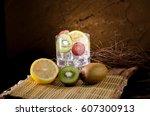 fruit cocktail on wooden...   Shutterstock . vector #607300913