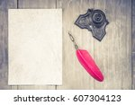 vintage red quill pen and... | Shutterstock . vector #607304123