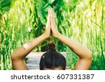 young woman practicing yoga... | Shutterstock . vector #607331387