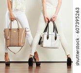 fashion concept. two slim women ... | Shutterstock . vector #607395263