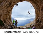 rock climbers in cave  belayers ...