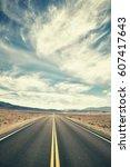 vintage toned desert road in...   Shutterstock . vector #607417643