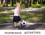 the little boy in the park... | Shutterstock . vector #607497593
