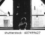 beautiful bride is in a dark... | Shutterstock . vector #607499627