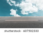 asphalt road and blue sky | Shutterstock . vector #607502333