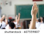 raised hands in class of middle