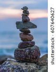 Small photo of Stones stacked and balanced in a tower on a beach, concept, we need balance in life.