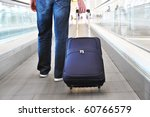 traveler with a suitcase on the ... | Shutterstock . vector #60766579