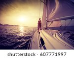 Couple On The Sailing Boat At...