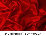 closeup of ripples in red silk... | Shutterstock . vector #607789127