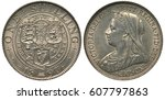 Small photo of United Kingdom British silver coin 1 one shilling 1897, three crowned shields with lions and harp and rose, thistle and clover within central circle, bust of Queen Victoria left, yellowish patina