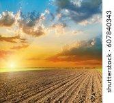 orange sunset over agricultural ... | Shutterstock . vector #607840343