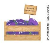 wooden box of eggplants....   Shutterstock .eps vector #607860467