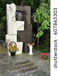 Small photo of MOSCOW, RUSSIA - May 30, 2011 Grave of Soviet Leader Nikita Khrushchev (1894-1971) in Novodevichy Cemetery. Black granite with white marble in cubist formations that bracket Khrushchev's bronze head.