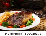 grilled beef steak served with... | Shutterstock . vector #608028173