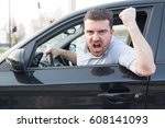 Small photo of Rude man driving his car and arguing a lot