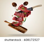 flying pieces of raw steaks ... | Shutterstock . vector #608172527