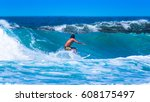 riding the waves. costa rica ... | Shutterstock . vector #608175497