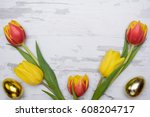 Colored Eggs And Tulips Over...
