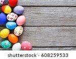 easter eggs on wood background. ...   Shutterstock . vector #608259533
