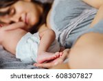 mother with newborn baby on the ... | Shutterstock . vector #608307827