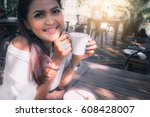 woman relaxing and drinking... | Shutterstock . vector #608428007