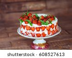 strawberry cake on a wooden... | Shutterstock . vector #608527613