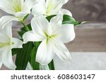 beautiful white lilies on... | Shutterstock . vector #608603147
