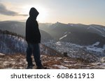 person stand back in mountains | Shutterstock . vector #608611913