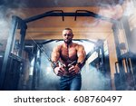 bodybuilder is working on his...   Shutterstock . vector #608760497