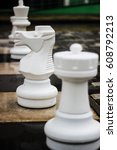 chessmen on the street after... | Shutterstock . vector #608792213
