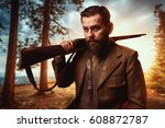 Small photo of Hunter in vintage hunting clothing with old gun