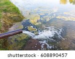 from the pipe water flows into... | Shutterstock . vector #608890457
