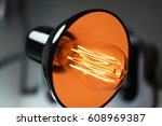 Small photo of Abstract idea of electric lamp 35W. Isolated on white background.