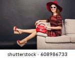 young beautiful stylish woman... | Shutterstock . vector #608986733