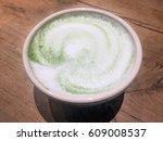 green tea latte with swirls in... | Shutterstock . vector #609008537