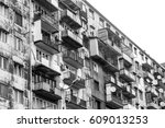 old gray highrise building | Shutterstock . vector #609013253