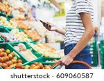 young woman shopping healthy... | Shutterstock . vector #609060587