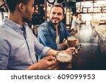handsome guys are drinking beer ... | Shutterstock . vector #609099953