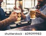 handsome guys are drinking beer ... | Shutterstock . vector #609099983