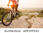 girl on mountain bike rides on... | Shutterstock . vector #609149333