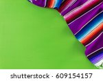 Small photo of sarape blanket on a bright green background.