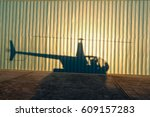 helicopter shadow on airplane... | Shutterstock . vector #609157283