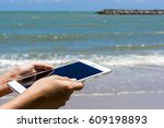 hand hold smartphone at the... | Shutterstock . vector #609198893