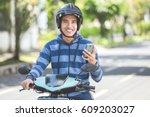portrait of happy asian man... | Shutterstock . vector #609203027