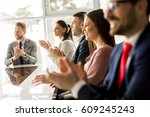 smiling business group clapping ... | Shutterstock . vector #609245243